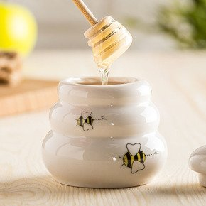 Porcelain honey pot with wooden dipper